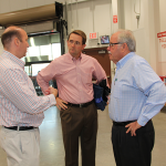 Hamburg developer Pat Madden, Stephen Gray of Gray Construction, and Jim Sinegal, co-founder and former CEO of Costco.