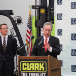 """Louisville Mayor Greg Fischer, right, and Lexington Mayor Jim Gray answer questions about the Bluegrass Economic Advancement Movement during a press conference at Clark Material Handling in Lexington. Fischer said Kentucky's real competitor is """"the rest of the globe."""""""