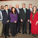 Nine high-tech companies moved to Kentucky from other states in 2013. Representatives from some of those companies posed for a photo Monday with Congressman Andy Barr, center, and some of the local officials who helped them get started in Central Kentucky.
