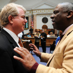 Rep. Derrick Graham, D-Frankfort (right), confers with Rep. David Floyd, R-Bardstown, during a recess period in the Kentucky House of Representatives.