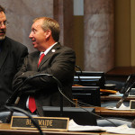 Rep. Myron Dossett, R-Pembroke (right), confers with Rep. Mike Harmon, R-Danville, prior to the start of the day's legislative session in the Kentucky House of Representatives.