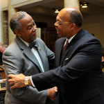 Sen. Reginald Thomas, D-Lexington (right), is congratulated on his recent election to the Kentucky Senate by Sen. Gerald Neal, D-Louisville.