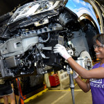 Ford employee Ellissia Freeman on the MKC assembly line before Ford Motor Co. announced the hiring of 300 new employees and a $129 million investment in Louisville Assembly Plant to support production of the all-new 2015 Lincoln MKC. (Photo by Sam VarnHagen/Ford Motor Co.)