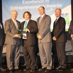 Mark Gumbert, third from left, CEO and principal biologist of Copperhead Environmental Consulting Inc. in Paint Lick, Ky., was named the EIEA 2014 winner in For-Profit Small Business; with him are, from left, Thomas Erekson, dean of the EKU College of Business and Technology; Ray Moncrief, executive vice president of Kentucky Highlands Investment Corp; Brett Traver, executive director of Southeast Kentucky Economic Development; Lonnie Lawson, president/CEO of The Center For Rural Development; and Michael Benson, president of EKU.