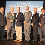 Greg Drury, third from left, owner of Harlan's Coal Fired Pizza (dba The Portal) in Harlan, Ky., was named the EIEA 2014 winner in Start-Up Business; with him are, from left, Thomas Erekson, dean of the EKU College of Business and Technology; Ray Moncrief, executive vice president of Kentucky Highlands Investment Corp; Brett Traver, executive director of Southeast Kentucky Economic Development; Lonnie Lawson, president/CEO of The Center For Rural Development; and Michael Benson, president of EKU.