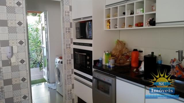 16. Cozinha + área de serviço