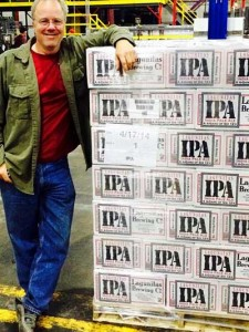 Tony Magee alongside the first Chicago batch of his flagship, Lagunitas IPA.