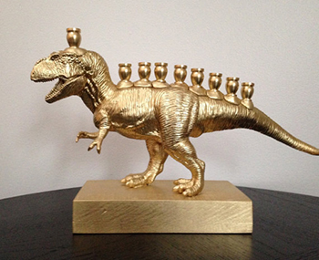 While the debate over whether he was a violent beast or merely a large scavenger rages on, no one can deny that T. Rex makes one heck of a Menorah. Image courtesy of Etsy.com.