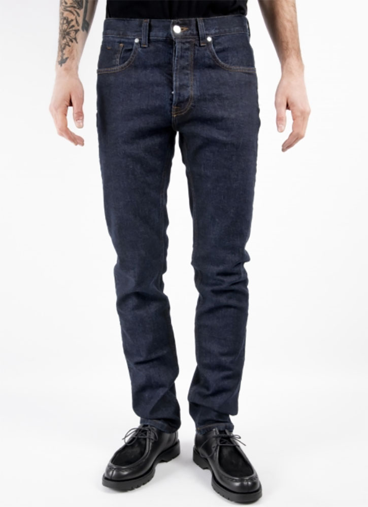 Men's blue blood rinsed jeans, available at Ateliers de Nîmes