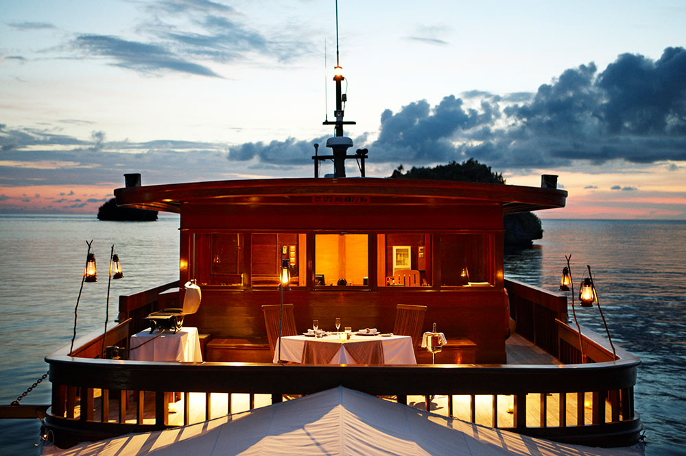 A private dinner on the sundeck of the <em>Amanikan</em>, which cruises through the Indonesian archipelago