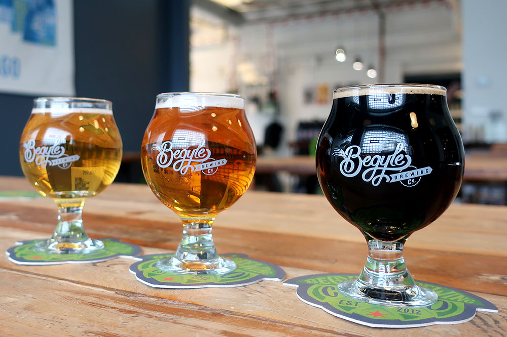 A beer flight featuring a Brut Früt Riot, a Goodbye Blue Monday oatmeal IPA and a barrel-aged Imperial Pajamas oatmeal stout from Begyle Brewing Co.