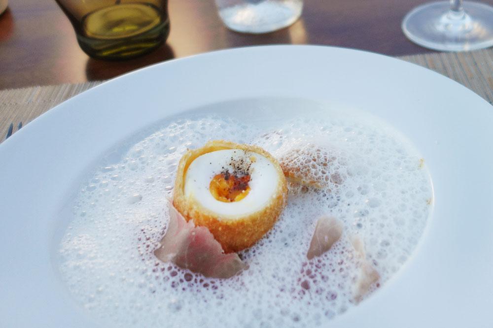 A coddled egg in a bread crumb crust with Corsican ham from <em>Tra di Noi</em> at Misincu