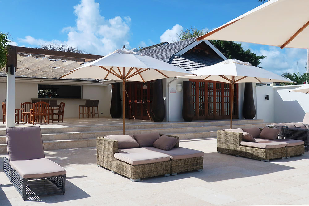 Loungers by the pool at Calabash Luxury Boutique Hotel