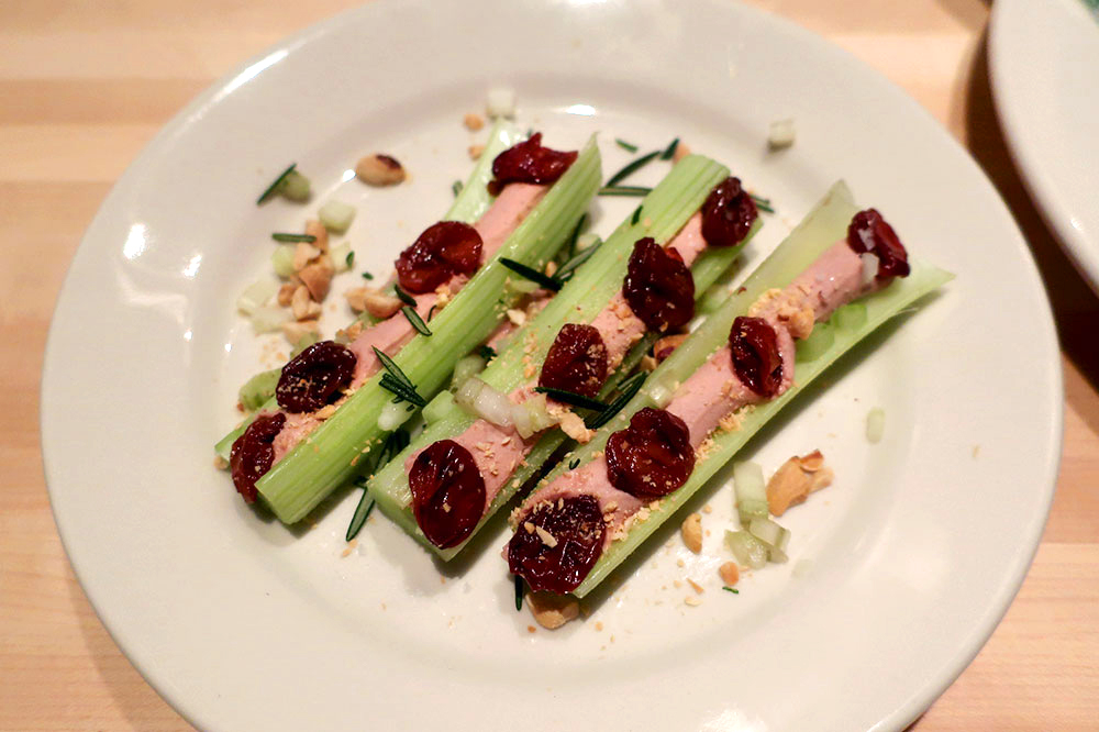 """Ants on a Log,"" celery topped with a mousse of duck liver and peanut butter, bourbon cherries and rosemary from Twain"