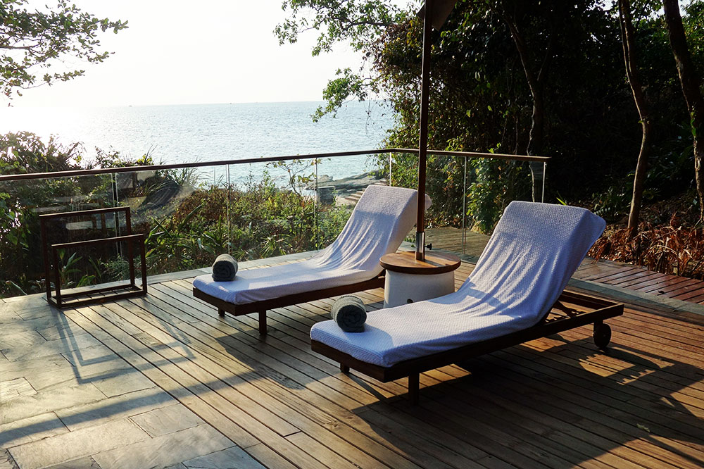 Lounge chairs by the private pool of our villa at Six Senses Krabey Island in Cambodia