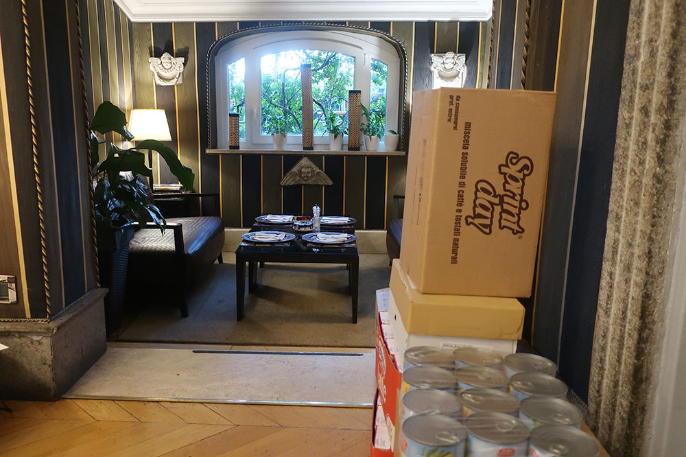 Delivery boxes stacked up in the breakfast area at The Inn at The Roman Forum