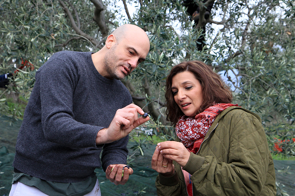 Choosing olives with a guest on her PBS show