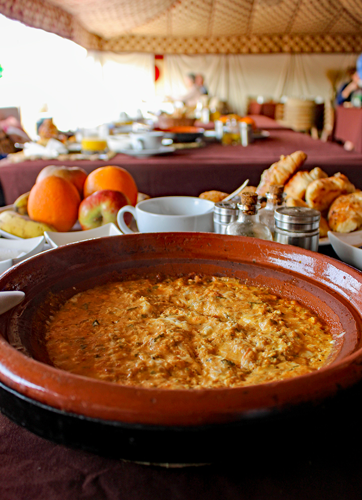 A breakfast tagine of eggs, tomato sauce and goat cheese at Erg Chebbi Luxury Desert Camp