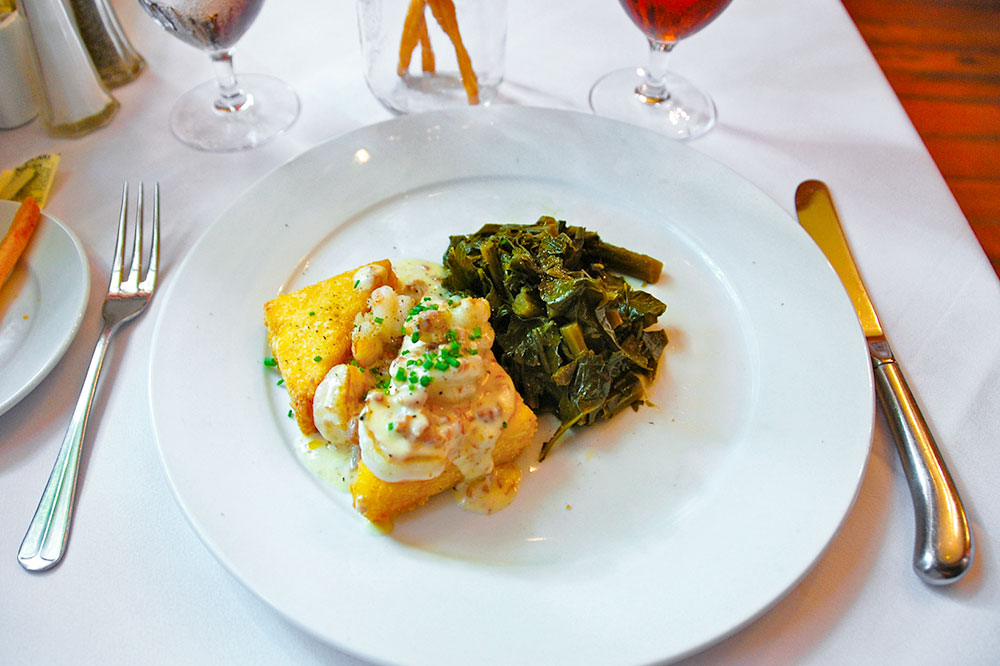 Shrimp and grits with collard greens at The Olde Pink House in Savannah