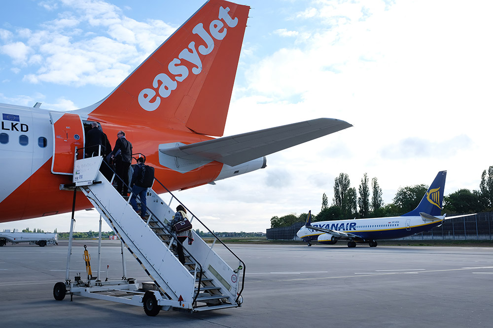 Discount airlines EasyJet and Ryanair stand on the tarmac at Tegel Airport in Berlin, Germany