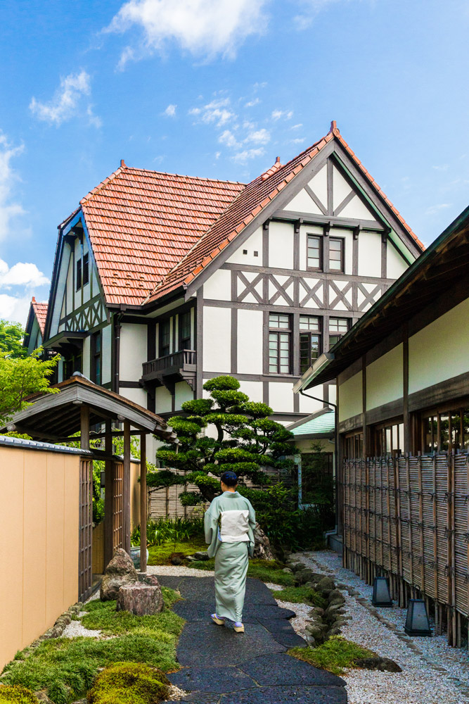 Our guide leads us past the original house at Gôra Kadan in Hakone, Japan