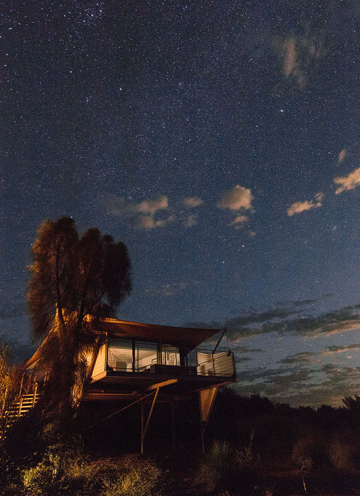 Luxury tent at night at Longitude 131° Lodge