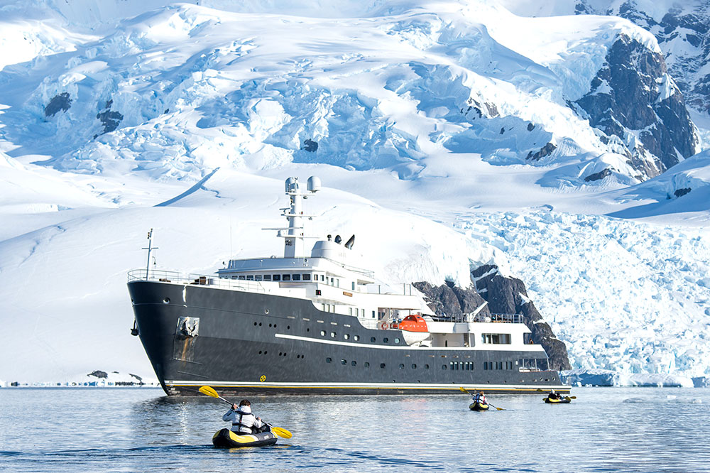 Kayakers near the EYOS Expeditions ship in Antarctica