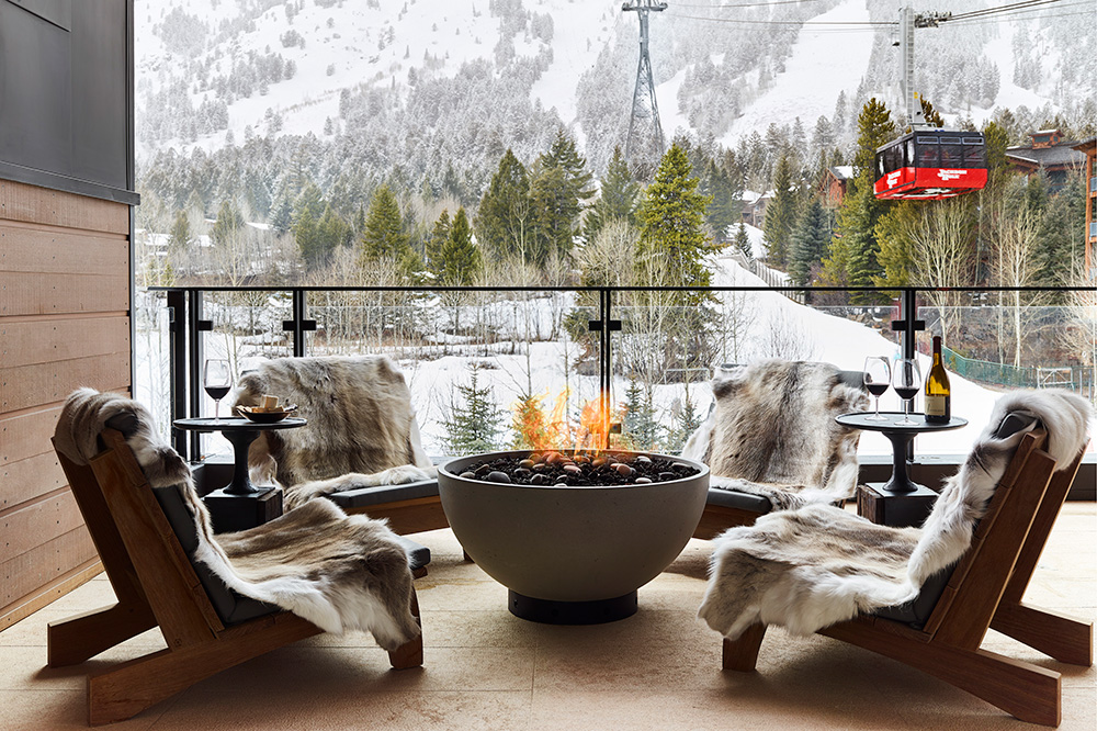 Fire pit at Caldera House with views of Jackson Hole Ski Resort, Wyoming