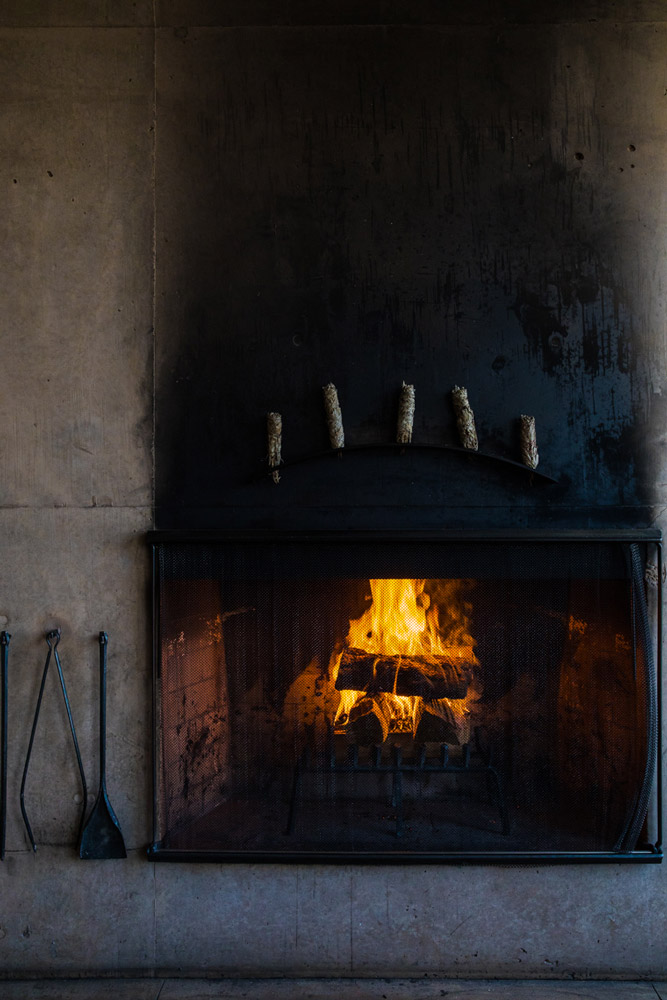 Fireplace with sage in the dining area at Amangiri