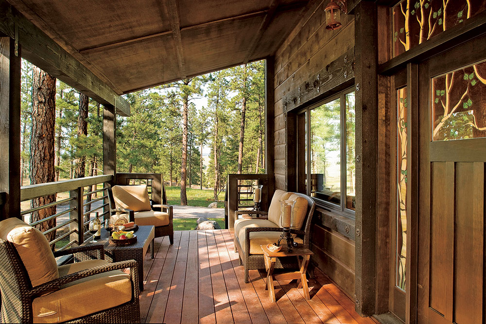 The front porch of a cabin at The Resort at Paws Up