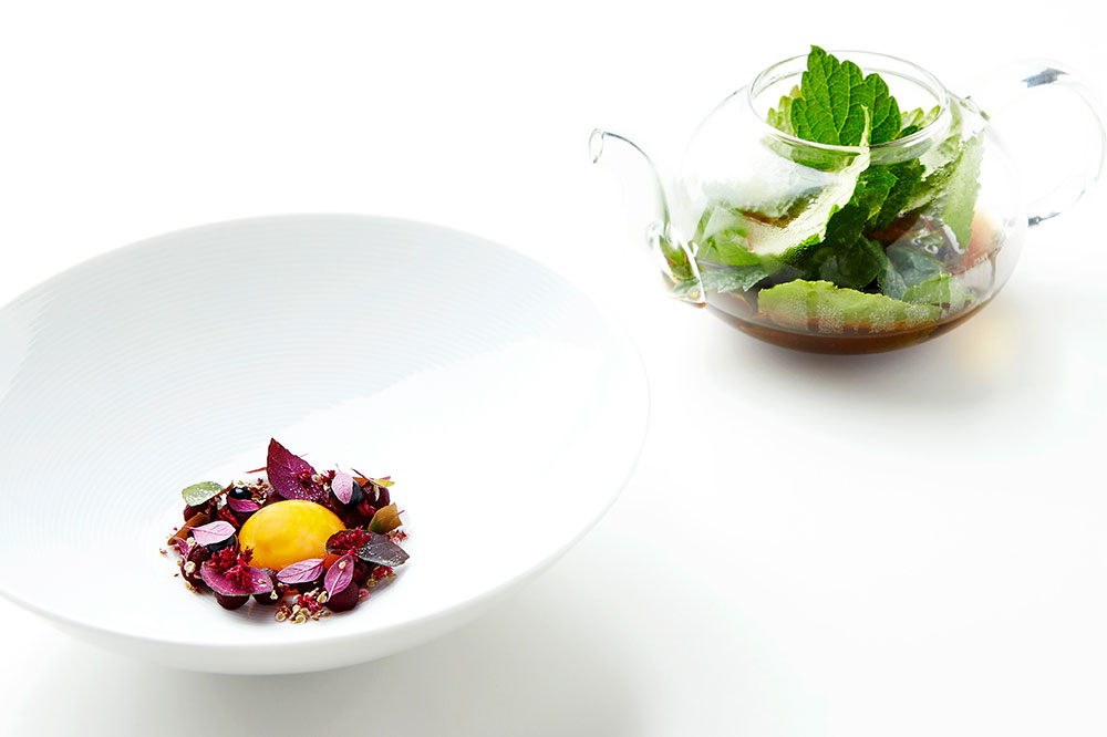 Egg yolk in melted pork fat with pickled beets and black-currant leaves from Geranium