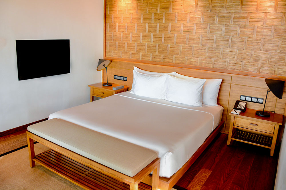 A guest room at Azerai Can Tho