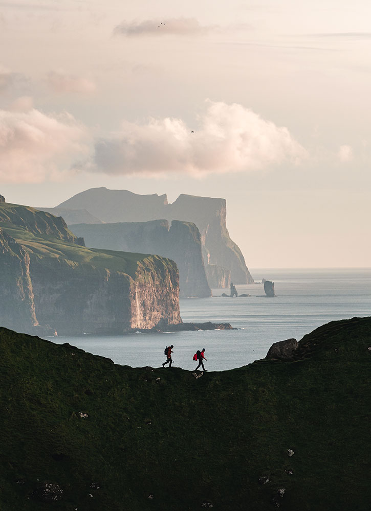 Hiking on Kalsoy island with views of Eysturoy and Streymoy islands