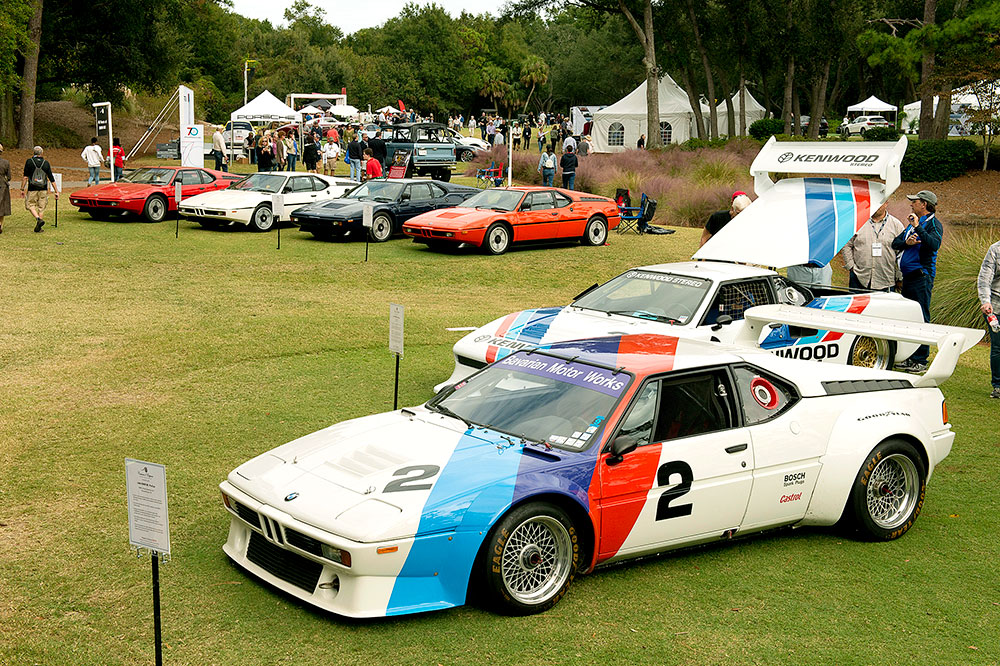 The BMW M1 anniversary class, including a 1979 BMW M1 from Bobby Rahal and a 1981 BMW M1 Group 5 from Lance White, at the 2018 Hilton Head Island Concours d'Elegance & Motoring Festival in Hilton Head Island, South Carolina