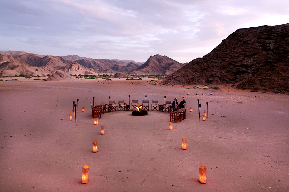 The fire pit set up at sunset at Hoanib Valley Camp
