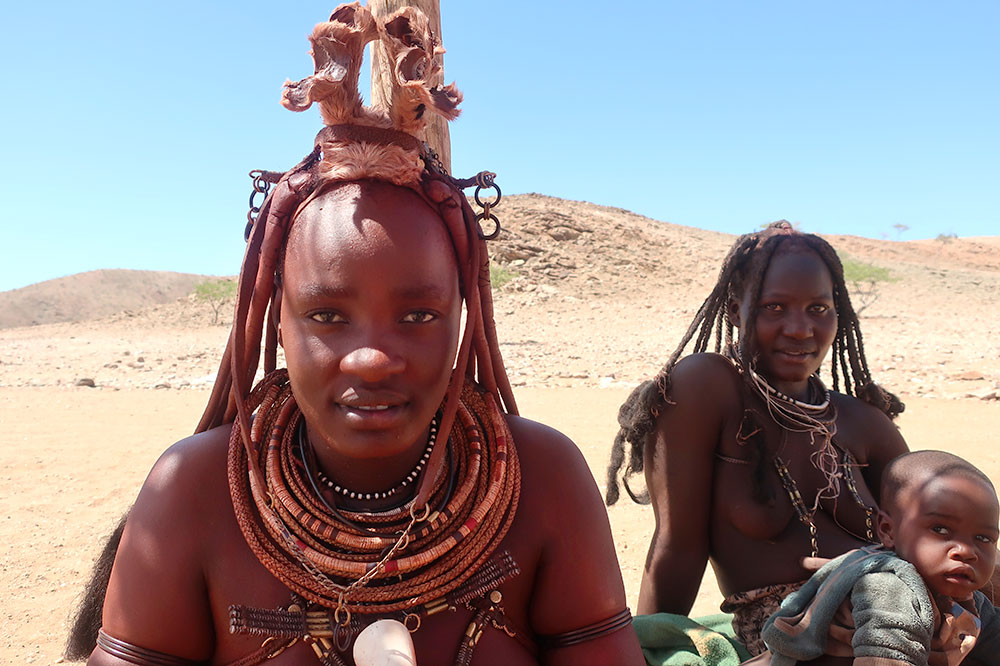 People of the Himba tribe, living in a village 90 minutes from Hoanib Valley Camp in the Hoanib Valley, Namibia