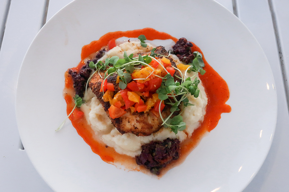Blackened mahi-mahi with roasted bell peppers, black olive tapenade and potato purée at Il Postino restaurant