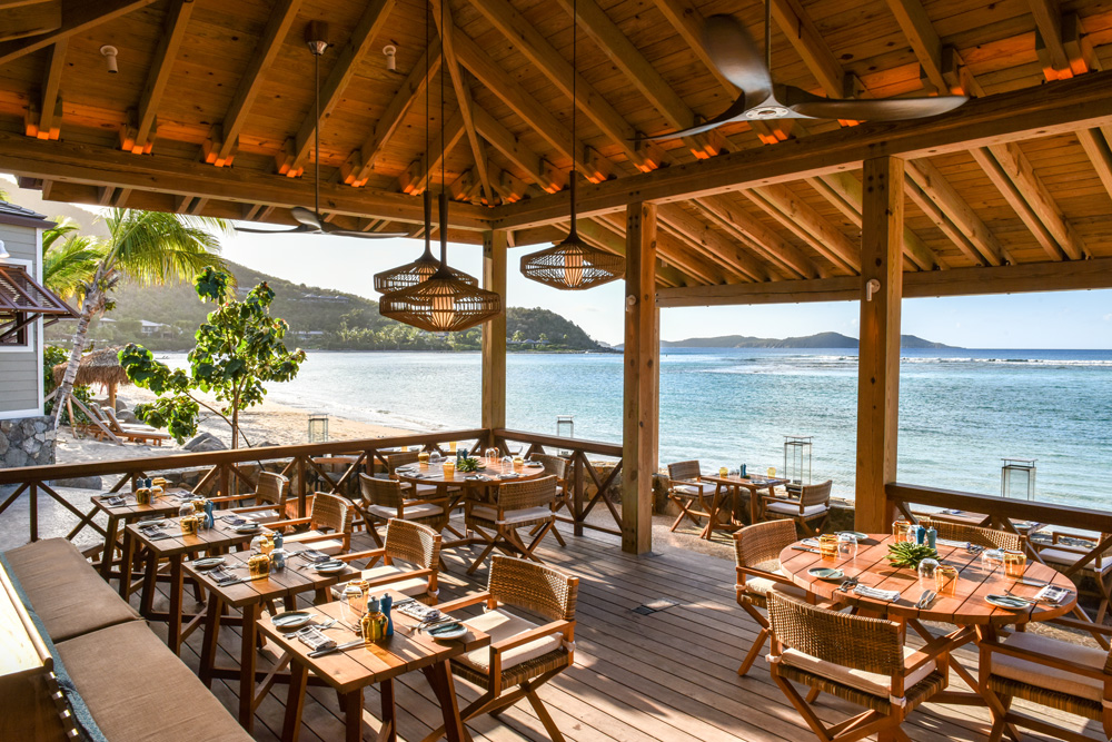 Reef House dining terrace at Little Dix Bay