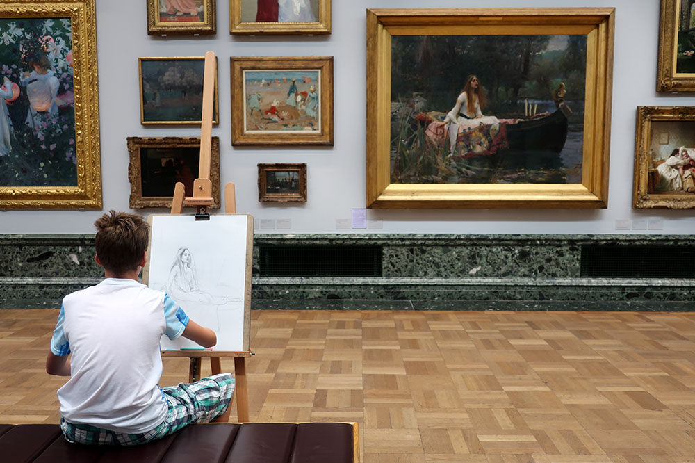 "A young boy re-creating ""The Lady of Shalott"" by John William Waterhouse at Tate Britain"