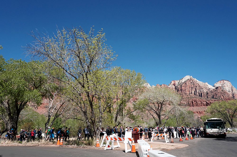 Visitors waiting to board shuttle buses at Zion National Park