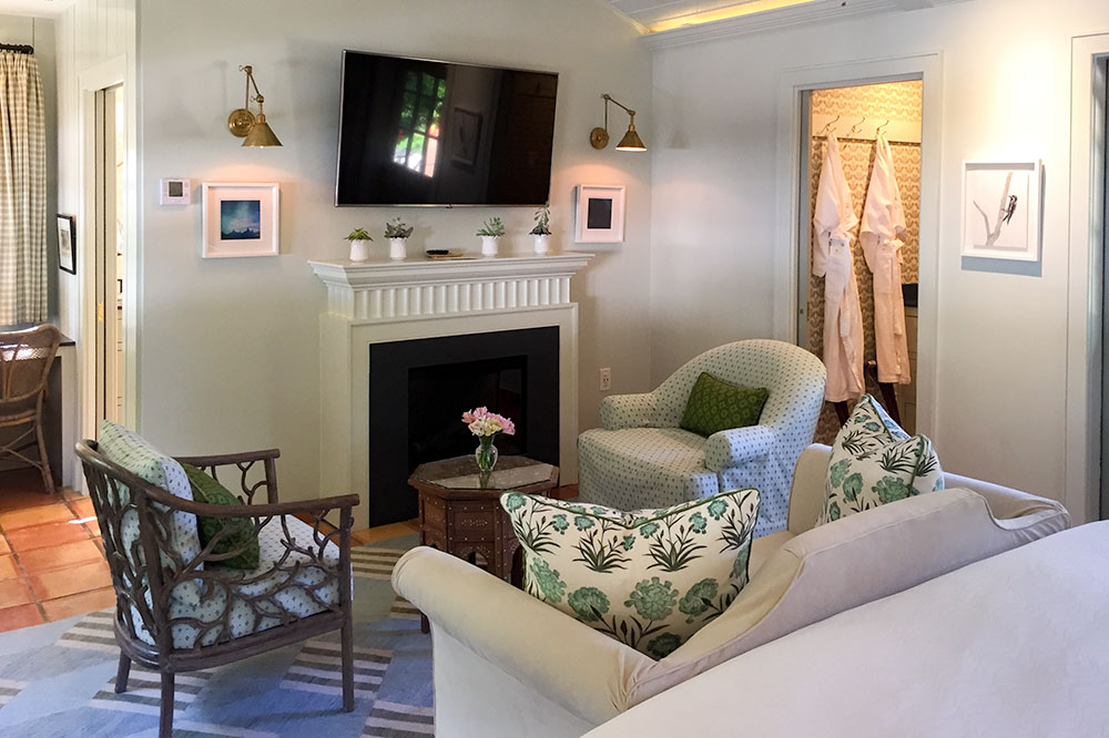 The Luxury Hot Tub Cottage living area with fireplace at Lake Austin Spa Resort