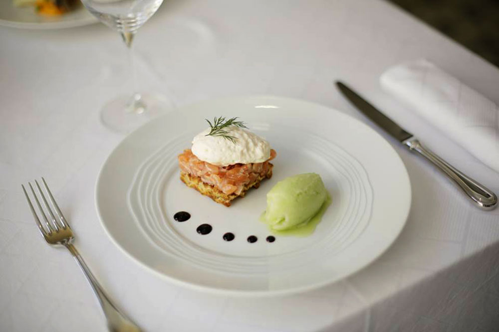Marinated salmon tartare, Parmesan waffle, smoked salmon emulsion and cucumber sorbet from La Maison