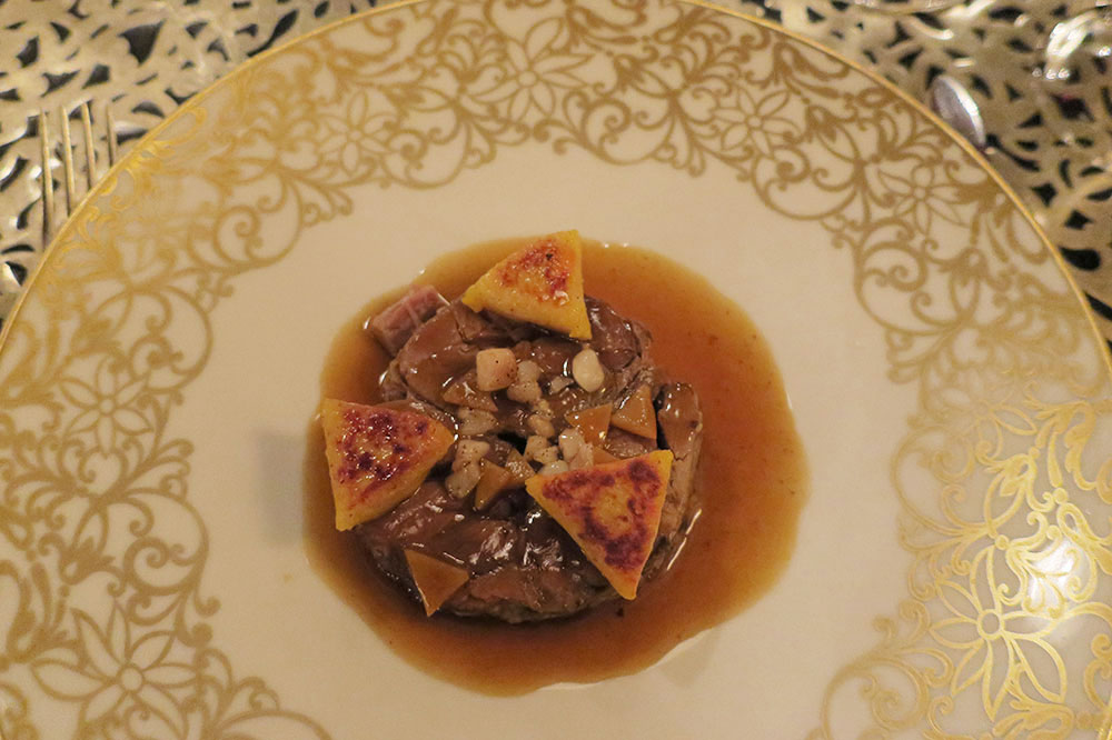 Beef shank and marrow tagine with gnocchi-like potato triangles and a jus infused with cumin, coriander and saffron from La Grande Table Marocaine restaurant at Royal Mansour in Marrakech, Morocco