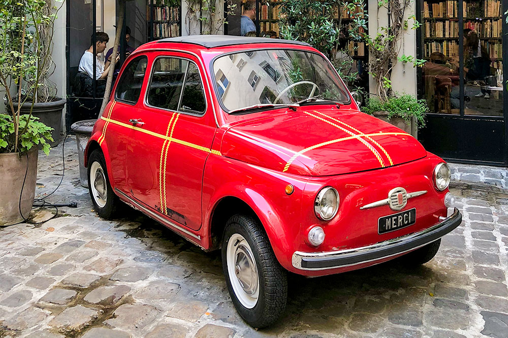 The red Fiat 500 just outside Merci's entrance is the store's trademark