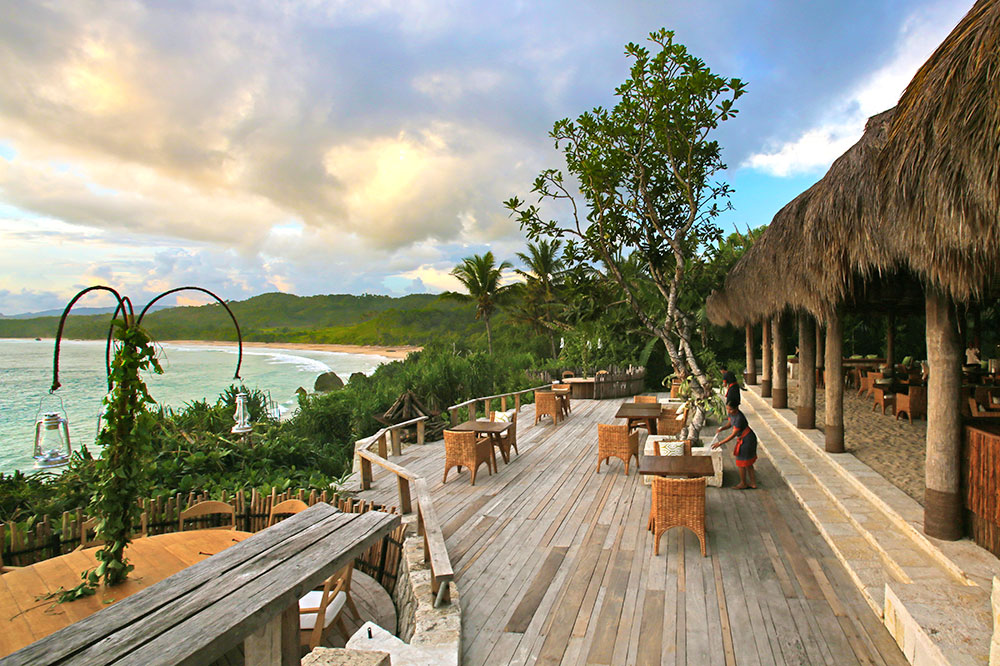 Outdoor seating at the Ombak restaurant at Nihi Sumba