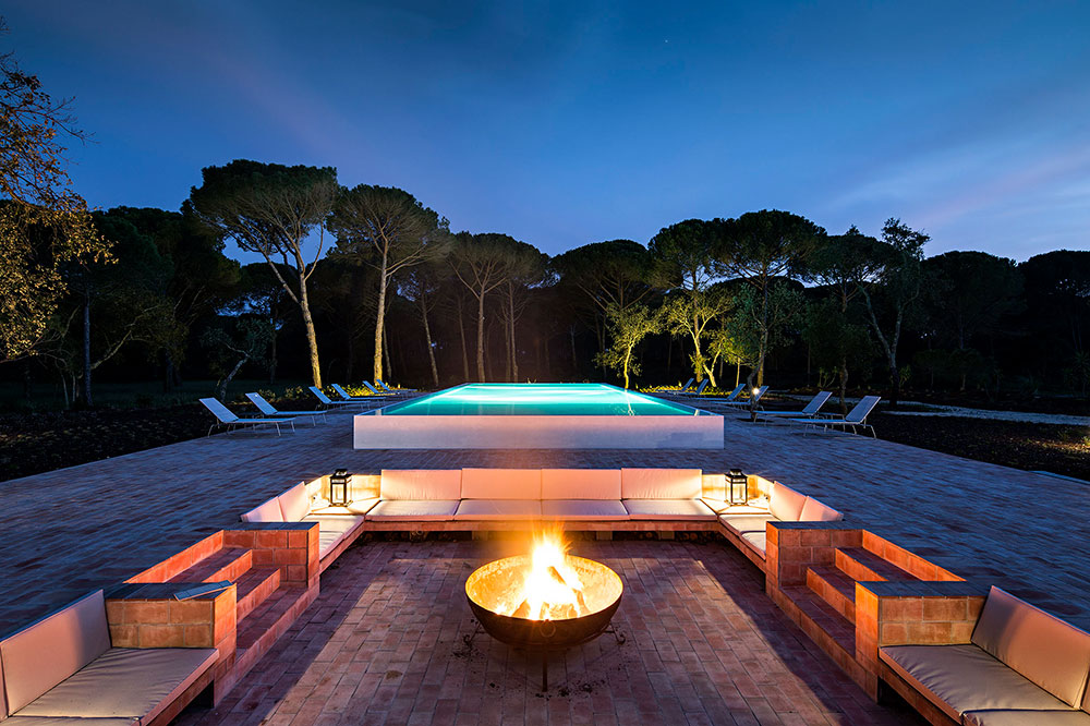 The outdoor pool and fire pit at Sublime Comporta