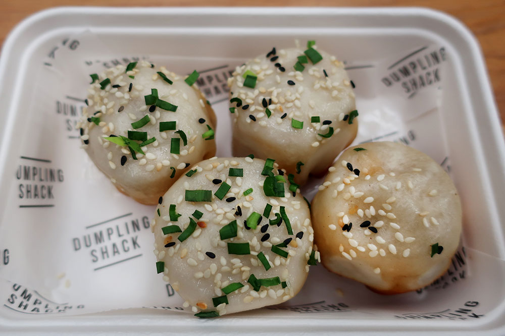Pan-fried pork-and-leek soup dumplings from the Dumpling Shack at Old Spitalfields Market in London