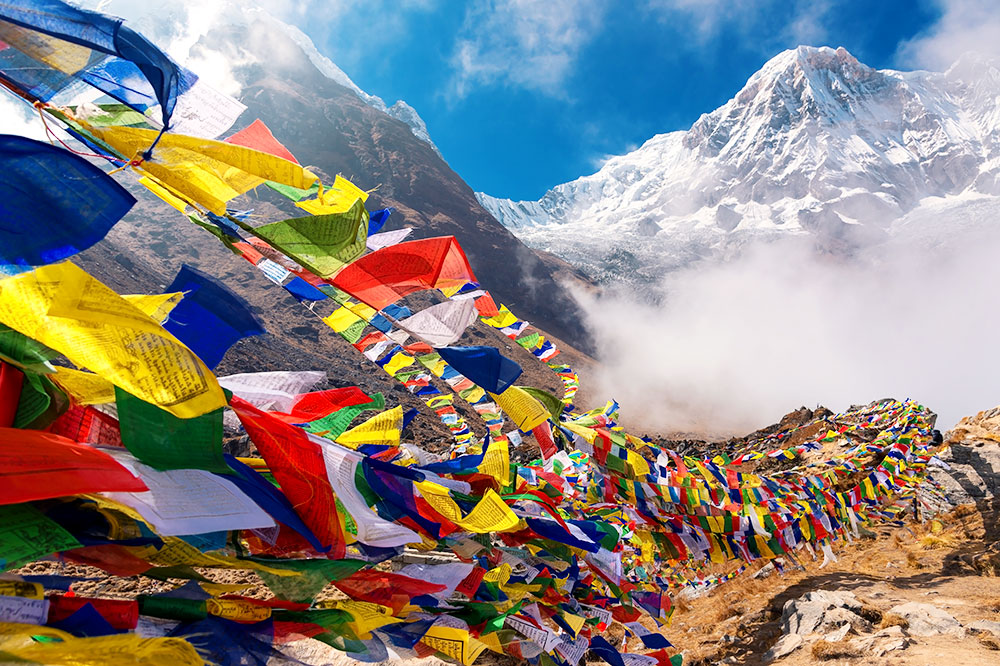 Prayer flags at the base camp of Mount Annapurna, seen in the background