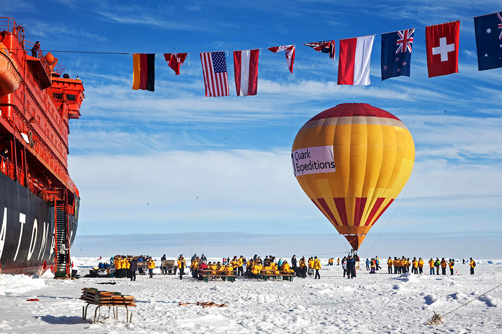 A hot air balloon next to the Quark Expeditions' icebreaker at the North Pole