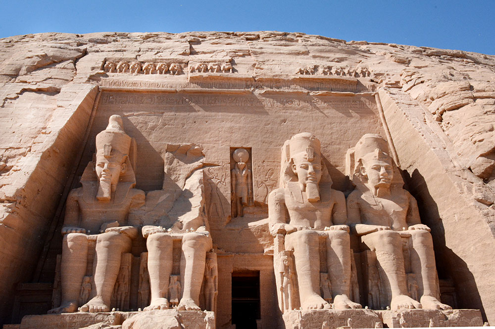 The Great Temple at Abu Simbel, depicting four seated colossi of Ramses, in Aswan, Egypt